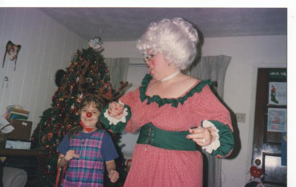 Mrs.Claus dancing with a young Rudolph